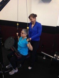 Cate doing some pull downs at Peddar Fitness for upper back strength. Go Cate!